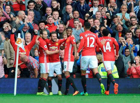 Manchester United's Juan Mata, 2nd left, celebrates with team mates after scoring during the English Premier League soccer match between Manchester United and Leicester City at Old Trafford in Manchester, England, Saturday, Sept. 24, 2016. (AP Photo/Rui Vieira)