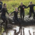 MUD FOR IT...One thousand people got down and dirty this year at Northern Ireland's muckiest event, McVitie's Jaffa Cakes Mud Madness, which took place on Sunday at Foymore Lodge in Portadown. Competitors came from all over Northern Ireland as well as Germany , Portugal , UK and ROI. Professional athletes, causal joggers and people who are just a bit bonkers made their way across 4.5 miles of bogs and ponds, under cargo nets and through water sprays and muddy trenches to help raise thousands of pounds for the official charity partner of the event, Action Cancer. Picture Mark Marlow/mudmadness