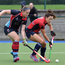Close quarters: Anna O'Flanagan of Hermes-Monkstown battles with Belfast Harlequins' Rachel Johnston