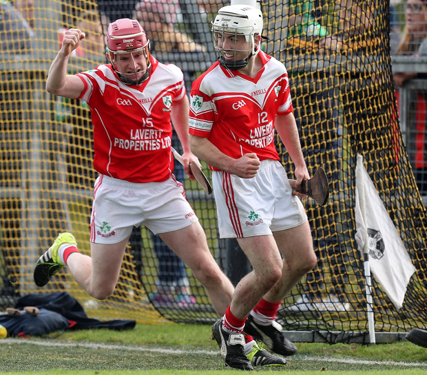 Up and running: Loughgiel's Shay Casey celebrates with team-mate Donal McKinley (right) after scoring his side's goal as they captured the Antrim senior title yesterday