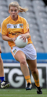 Making ground: Mairead Cooper launches an attack for Antrim