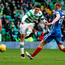Pinpoint: Tom Rogic completes the scoring for Celtic against Kilmarnock