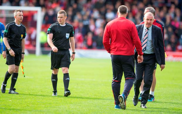 Angry: Rangers manager Mark Warburton storms off after a post-match confrontation with referee John Beaton at Pittodrie