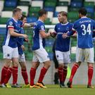 In control: Kirk Millar enjoys the moment after bagging Linfield's third goal