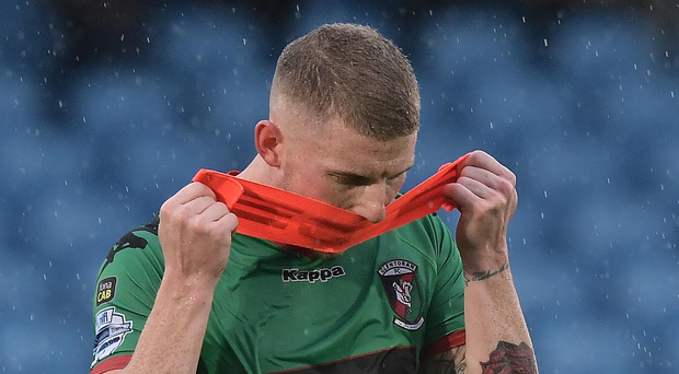 Down in the mouth: Eric Foley shows his dejection as he trudges off in the aftermath of Glentoran's latest defeat