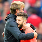 Strong as houses: Jurgen Klopp and Adam Lallana celebrate after the final whistle at Anfield