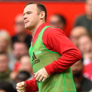 Sidelined: Wayne Rooney had to contend with a place on the bench at the weekend and appears increasingly unlikely to replicate images of the new deal agreements he reached with United in both 2010 and 2013