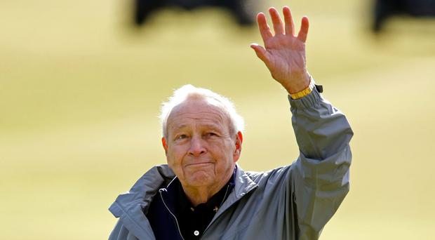 File photo dated 15-07-2015 of Arnold Palmer acknowledging the crowd on the 18th during the Champions Challenge at St Andrews, Fife. PA