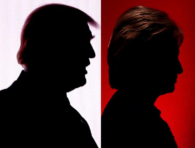 Silhouettes of Republican presidential nominee Donald Trump and Democratic presidential nominee Hillary Clinton. AFP/Getty Images file photo