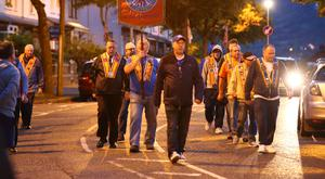 Orangemen parade along Twaddell Avenue in north Belfast last night