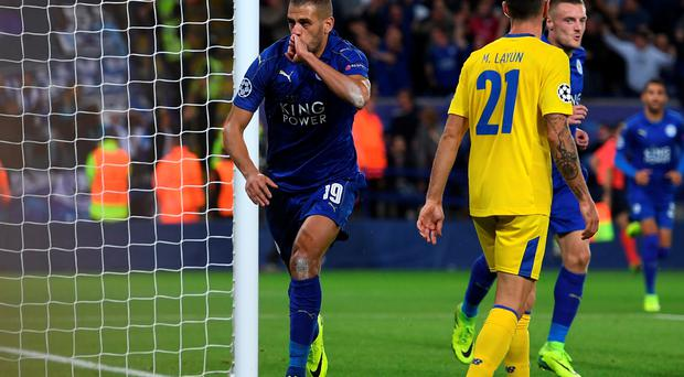 Record: Islam Slimani celebrates his latest goal against Porto