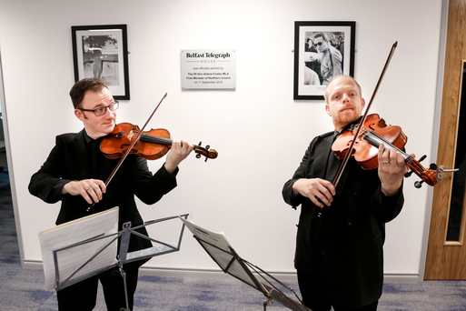 Violinists Jonathan Simmance and David McCann Williams visit the Belfast Telegraph offices as part of 50 pop-up performances to mark 50 years of the Ulster Orchestra. Kevin Scott/Belfast Telegraph