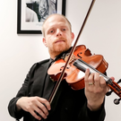 Violinists Jonathan Simmance and David McCann Williams visit the Belfast Telegraph offices as part of 50 pop-up performances to mark 50 years of the Ulster Orchestra.