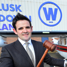 Aidan Larkin of Wilsons Auctions with a plane used in an attempt to smuggle drugs that the firm later sold off