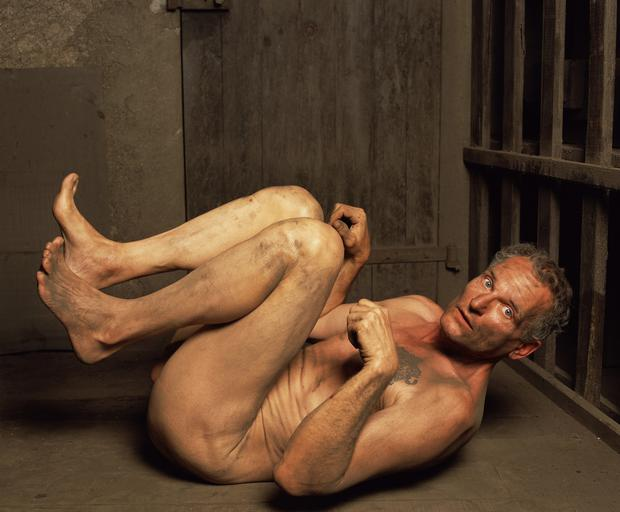 A photo from the exhibition entitled 'Torture' by Andres Serrano