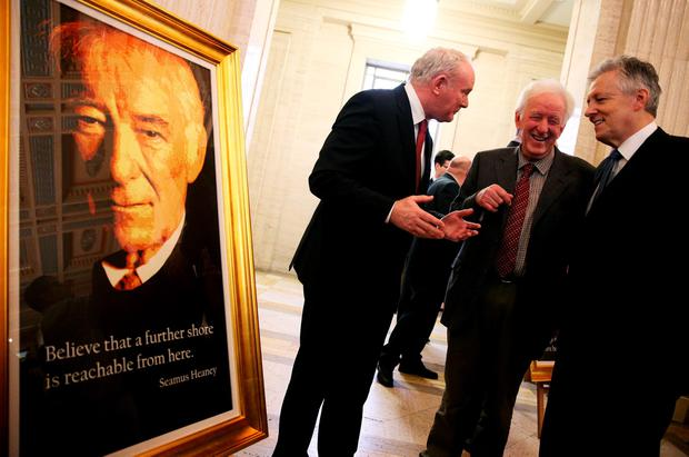 Hugh Heaney, brother of poet Seamus Heaney, pictured with Martin McGuinness and Peter Robinson, at a portrait unveiling at Stormont in Belfast in November 2015.