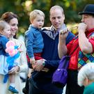 VICTORIA, BC - SEPTEMBER 29: Catherine, Duchess of Cambridge, Princess Charlotte of Cambridge and Prince George of Cambridge, Prince William, Duke of Cambridge at a children's party for Military families during the Royal Tour of Canada on September 29, 2016 in Carcross, Canada. Prince William, Duke of Cambridge, Catherine, Duchess of Cambridge, Prince George and Princess Charlotte are visiting Canada as part of an eight day visit to the country taking in areas such as Bella Bella, Whitehorse and Kelowna (Photo by Chris Jackson - Pool/Getty Images)