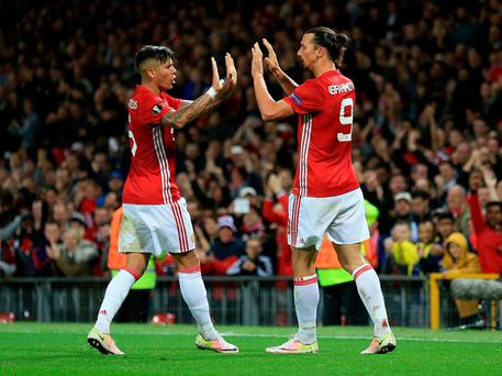 Manchester United's Zlatan Ibrahimovic (right) celebrates scoring his side's first goal of the game with team-mate Manchester United's Marcos Rojo (left) during the UEFA Europa League, Group A match at Old Trafford, Manchester. Nigel French/PA Wire
