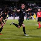 Man of the moment: Ciaran Kilduff wheels away after netting Dundalk's winner in Tallaght