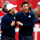 Europe's Rory McIlroy (right) and Andy Sullivan (left) during day one of the 41st Ryder Cup at Hazeltine National Golf Club in Chaska, Minnesota, USA.