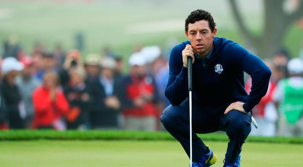CHASKA, MN - SEPTEMBER 30: Rory McIlroy of Europe lines up a putt on the second green during morning foursome matches of the 2016 Ryder Cup at Hazeltine National Golf Club on September 30, 2016 in Chaska, Minnesota. (Photo by Andrew Redington/Getty Images)