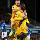 Heads up: Christian Benteke (right) and James McArthur