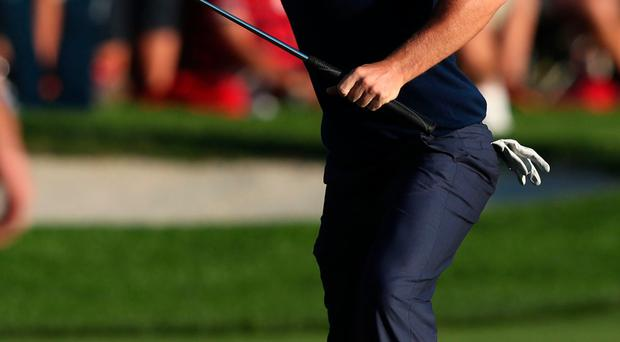 Decisive: Rory McIlroy celebrates after holing his winning putt to bring Europe back to 5-3