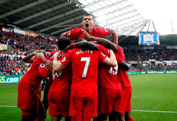 Dejan Lovren of Liverpool celebrates his side's second goal with his team mates during the Premier League match between Swansea City and Liverpool at Liberty Stadium on October 1, 2016 in Swansea, Wales. (Photo by Julian Finney/Getty Images)