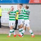 Celtic's Scott Brown (left) celebrates scoring his side's first goal of the game during the Scottish Premiership match at Dens Park, Dundee. PA