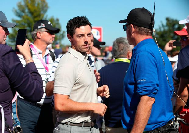 Europe's Rory McIlroy speaking with spectator in the crowd between the 7th and 8th during the Fourballs on day two of the 41st Ryder Cup at Hazeltine National Golf Club in Chaska, Minnesota, USA. David Davies/PA Wire.