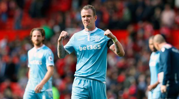 Stoke City's Glenn Whelan celebrates after the Premier League match at Old Trafford, Manchester. Martin Rickett/PA Wire.