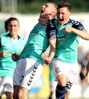 Striking it hot: Derry City's Ronan Curtis celebrates scoring their second goal of the game with Conor McDermott