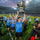 Ecstacy and agony: Dublin's Diarmuid Connolly leads the Sam Maguire celebrations