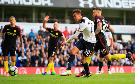 Net gains: Dele Alli sweeps home Spurs' second against City at White Hart Lane