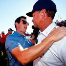 Well done: Rory McIlroy congratulates Davis Love