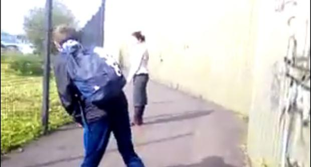 Northern Ireland schoolboys throw stones and abuse at Romanian woman.