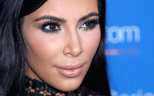 File photo, Kim Kardashian poses during a photo call at the Cannes Lions 2015. A spokeswoman for Kardashian West says she was held up at gunpoint inside her Paris hotel room Sunday, Oct. 2, 2016, by two armed masked men dressed as police officers. (AP Photo/Lionel Cironneau, File)