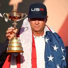 Captain fantastic: Davis Love holding the Ryder Cup