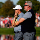 Falling down: Captain Darren Clarke looks on as Europe come unstuck against the US
