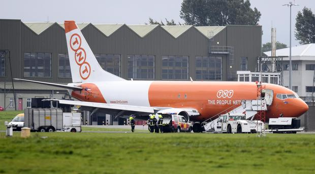There was significant disruption at Belfast International Airport after a freight plane got stuck on the runway due to a burst tyre