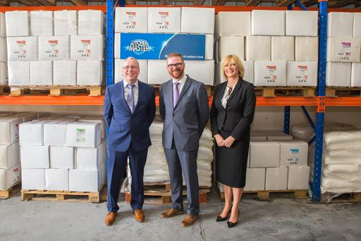From left, Kitchenmaster managing director Brian O'Kane with Economy Minister Simon Hamilton and the firm's sales director Jacqui Walsh