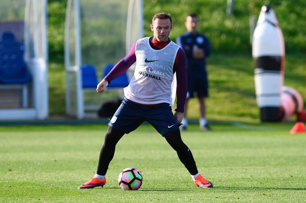 On the ball: Wayne Rooney at England training yesterday
