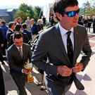 Tribute: Golfers Bubba Watson (right) and Rickie Fowler arrive at the memorial service for Arnold Palmer in Pennsylvania with the Ryder Cup