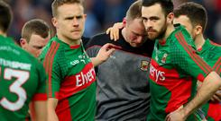 Tough day: Mayo goalkeeper Robert Hennelly is consoled by Andy Moran and Kevin McLoughlin