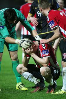 Dejected: Ronan Curtis is consoled by his team-mates