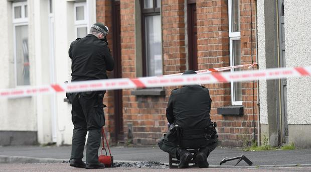 Police carry out searches at the scene as police investigate reports of shots fired at two properties in Lurgan. Pic Colm Lenaghan/Pacemaker
