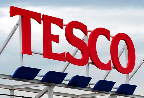 Tesco has revealed half-year profits dropped by more than a quarter, but notched up a third quarter in a row of sales growth