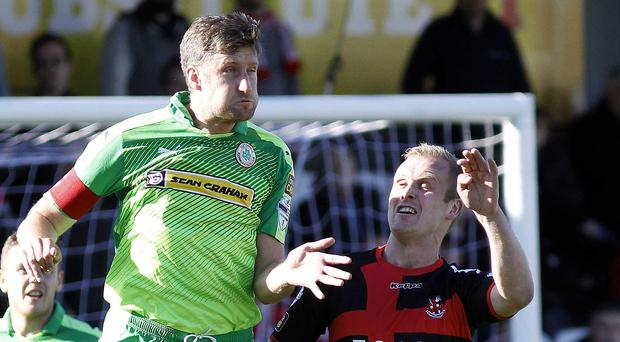 Cliftonville captain Jason McGuinness (left) wants his teammates to respond to their 4-3 derby day defeat against Crusaders
