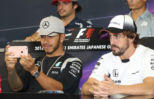 Picture this: Lewis Hamilton takes videos and pictures on Snapchat during the press conference ahead of the Japanese Grand Prix in Suzuka