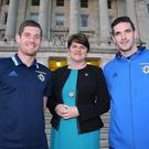 All smiles: First Minister Arlene Foster welcomes Northern Ireland goalkeeper Michael McGovern and striker Kyle Lafferty to Stormont last night for a reception to recognise the achievements of the squad at the Euro 2016 finals in France